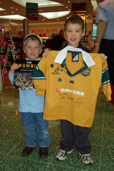 Kids with signed jersey